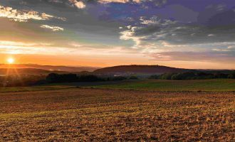 Sunset Over the Plains Christian Stock Photo