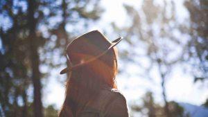 Girl in Fedora Staring at the Sun Christian Stock Photo耳を澄ませて
